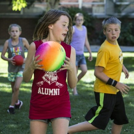 Kids playing outdoor team sports with balls